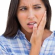 Brunette with a toothache — Stock Photo