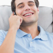 Man laughing while being on the phone — Stock Photo