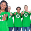 Stock Photo: Team of female environmental activists smiling at camerand giv