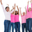 Cheering women wearing breast cancer ribbons — Stock Photo
