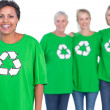 Happy women wearing green recycling tshirts — Stock Photo