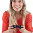 Blonde woman playing video games — Stock Photo