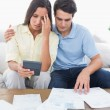 Fearful couple doing their accounts — Stock Photo