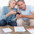 Worried couple going over their debt  — Stock Photo
