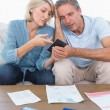 Worried couple going over their debt — Stock Photo #28057139