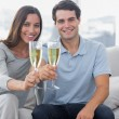 Portrait of lovers toasting their flutes of champagne — Stock Photo #28057253