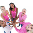 Happy women wearing pink and ribbons for breast cancer putting h — Stock Photo