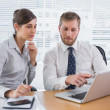 Stock Photo: Business people working together on laptop