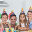 Parents celebrating their daughter birthday — Stock Photo #28057437