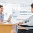 Businesswoman interviewing disabled candidate — Stock Photo