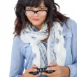 Beautiful woman wearing scarf and glasses playing video games — Stock Photo