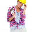 Handy woman touching her helmet and holding paintbrush — Stock Photo #28057663