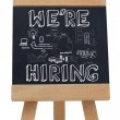 Stock Photo: We are hiring written with chalk