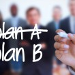 Stock Photo: Businessmwriting plB with marker