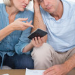 Anxious couple going over their debt — Stock Photo
