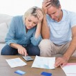 Worried couple going over finances — Stock Photo