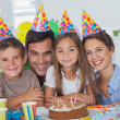 Beautiful family celebrating a party — Stock Photo #28058403