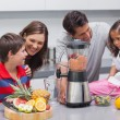 Stock Photo: Family using blender