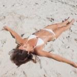Sunbathing woman lying on beach — Stock Photo #28058509