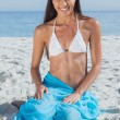 Stock Photo: Smiling womwearing sarong