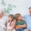 Grandparents speaking with their grandchildren — Stock Photo