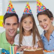 Parents celebrating their little girls birthday — Stock Photo #28058801
