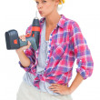 Serious handy womwith power drill — Stock Photo #28058807