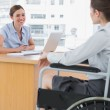Businesswoman interviewing disabled job candidate — Stock Photo