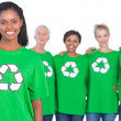 Team of female environmental activists smiling at camera — Stock Photo #28059179