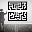 Businessman drawing a line through qr code — Stock Photo