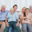 Portrait of an extended family sitting on couch — Stock Photo