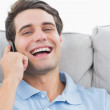 Man laughing while having a phone conversation — Stock Photo