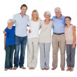 Family standing against a white background — Stock Photo