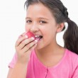 Smiling little girl eating apple — Stock Photo