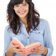 Young woman wearing glasses and holding book — Stock Photo