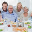 Extended family smiling at dinner family — Stock Photo #28059965