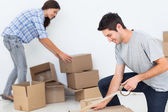 Woman and man wrapping boxes — Stock Photo