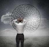 Anxious businessman looking at maze — Stock Photo