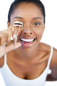 Happy woman using curler for her eyelash — Stock Photo
