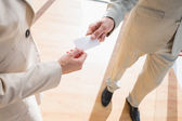 Businessman passing his card to businesswoman — Stock Photo