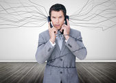 Businessman trapped by telephone wires — Stock Photo