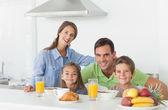 Portrait of cute family having breakfast — Stock Photo