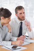 Business people discussing documents — Stock Photo