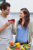 Lovely couple clinking glass of red wine — Stock Photo
