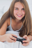 Portrait of a young girl playing video games — Stock Photo