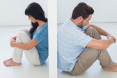 Sitting couple are separated by white wall — Stock Photo