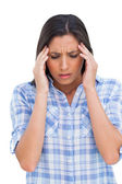 Woman with a headache rubbing her temples — Stock Photo