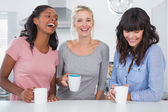 Happy friends having coffee together — Stock Photo