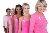Group of diverse women wearing pink tops and ribbons for breast — Stock Photo