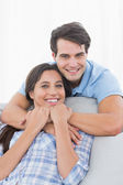 Portrait of a man embracing his partner — Stock Photo